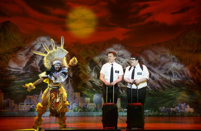"Monica L. Patton, David Larsen and Cody Jamison Strand in the second national tour of the nine-time Tony Award-winning ""The Book of Mormon"" now at the Smith Center for the Performing Arts through July 6, 2014."