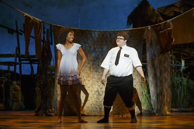 "Denee Benton and Cody Jamison Strand in the second national tour of the nine-time Tony Award-winning ""The Book of Mormon"" now at the Smith Center for the Performing Arts through July 6, 2014."