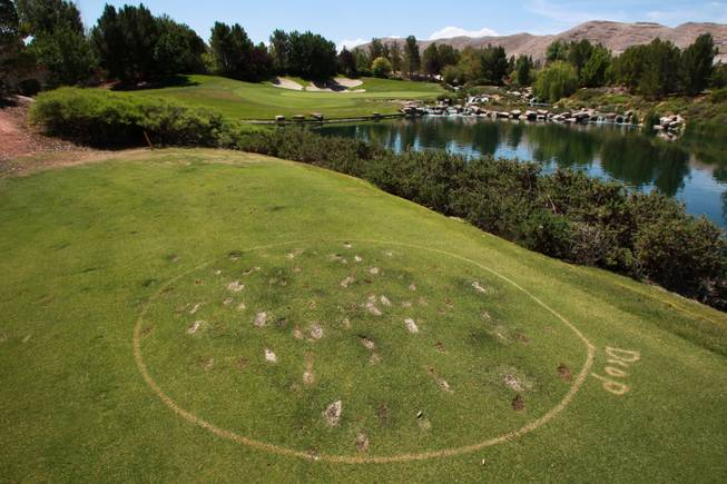 An oft used ball drop area is seen on the par 3 17th hole at Southern Highlands Golf Club May 22, 2014.