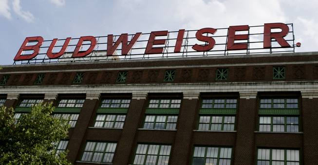 The name Budweiser is seen spelled out above the Bevo Building on the brewery's St. Louis complex Tuesday, July 26, 2005.