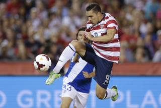 The United States' Herculez Gomez, right, shoots on goal as Guatemala's Victor Hernandez, behind, defends in the second half during an international friendly soccer match Friday, July 5, 2013, in San Diego.