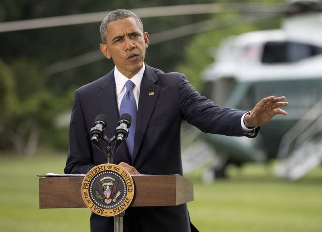 President Barack Obama talks about his administration's response to a growing insurgency foothold in Iraq, Friday, June 13, 2014, on the South Lawn of the White House in Washington, prior to boarding the Marine One Helicopter for Andrews Air Force Base, Md., then onto North Dakota and California.