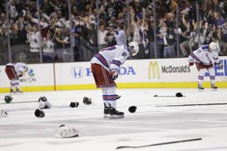 New York Rangers left wing Benoit Pouliot looks down after losing to the Los Angeles Kings during overtime in Game 5 of the NHL Stanley Cup Final series Friday, June 13, 2014, in Los Angeles. (AP Photo/Gregory Bull)