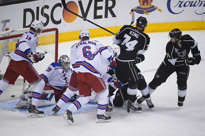 Los Angeles Kings right wing Justin Williams, right, watches as the puck enters the net, left, for a goal against the New York Rangers during the first period in Game 5 of the NHL Stanley Cup Final series Friday, June 13, 2014, in Los Angeles.