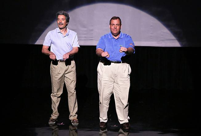 "This Thursday, June 12, 2014, photo provided by NBC shows host Jimmy Fallon, left, and Governor Chris Christie during the ""Evolution of Dad Dancing"" skit on ""The Tonight Show Starring Jimmy Fallon."""