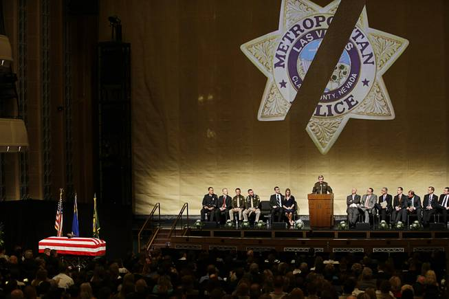 County Sheriff Doug Gillespie speaks at a memorial service for Las Vegas Metropolitan Police Officer Alyn Beck at The Smith Center for the Performing Arts Saturday, June 14, 2014 in Las Vegas. Two suspects shot and killed Beck, 41, and fellow police officer Igor Soldo, 31, in an ambush at a Las Vegas restaurant Sunday, June 8, 2014, before fatally shooting a third person inside a nearby Wal-Mart, authorities said.
