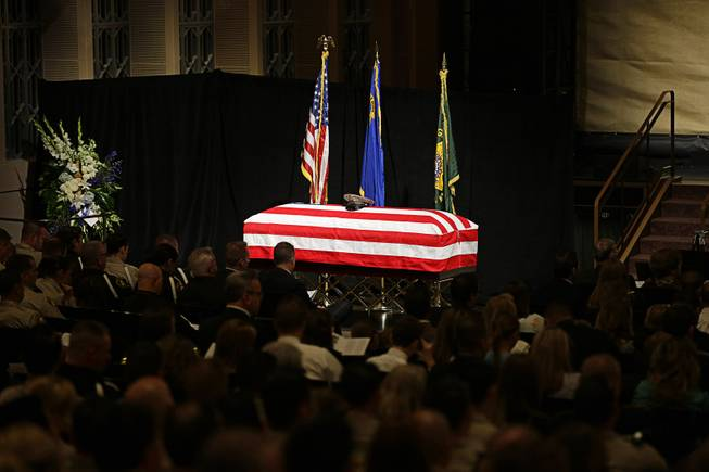 A flag covers the casket of Las Vegas Metropolitan Police Officer Alyn Beck during his memorial service at The Smith Center for the Performing Arts Saturday, June 14, 2014 in Las Vegas. Two suspects shot and killed Beck, 41, and fellow police officer Igor Soldo, 31, in an ambush at a Las Vegas restaurant Sunday, June 8, 2014, before fatally shooting a third person inside a nearby Wal-Mart, authorities said.