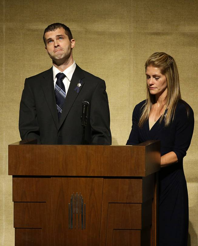 Joseph Beck, left, and Elizabeth Krmpotich speak during a memorial service for their brother Las Vegas Metropolitan Police Officer Alyn Beck at The Smith Center for the Performing Arts Saturday, June 14, 2014 in Las Vegas. Two suspects shot and killed Beck, 41, and fellow police officer Igor Soldo, 31, in an ambush at a Las Vegas restaurant Sunday, June 8, 2014, before fatally shooting a third person inside a nearby Wal-Mart, authorities said.