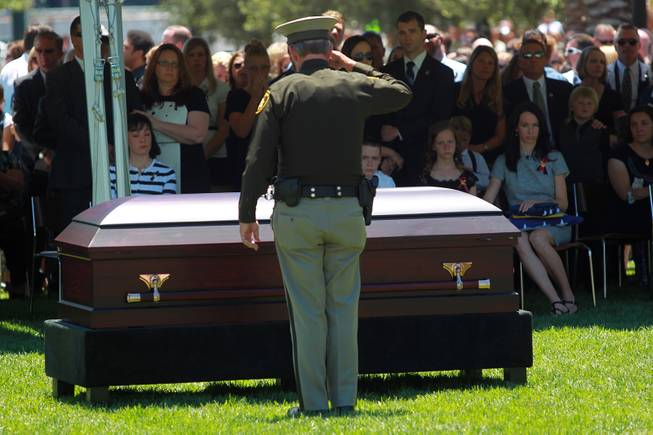 Sheriff Doug Gillespie salutes the casket Metro officer Alyn Beck during a memorial service Saturday, June 14, 2014 at the Smith Center for the Performing Arts.