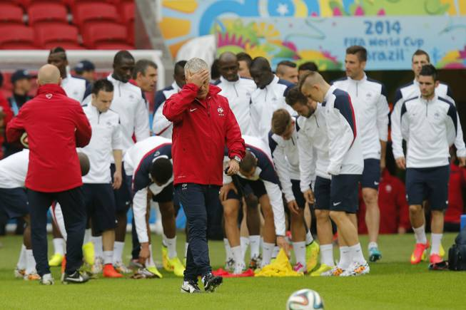 France's soccer team head coach Didier Deschamps gestures during an official training at the Estadio Beira-Rio in Porto Alegre, Brazil, Saturday, June 14, 2014. France will play in group E of the World Cup.