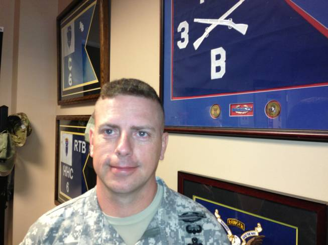 "Lt. Col. Patrick Harkins poses for a photo on May 19, 2014, at Fort Campbell, Ky. Harkins has followed in his dad's footsteps. His dad, retired Col. Bob Harkins, led the ""Rakkasans,"" the 187th Infantry Division, 3rd Brigade Combat Team of the 101st Airborne Division at Fort Campbell into combat at the Battle of Hamburger Hill in May 1969 in Vietnam. Four decades later, his son led the unit into combat in Afghanistan."