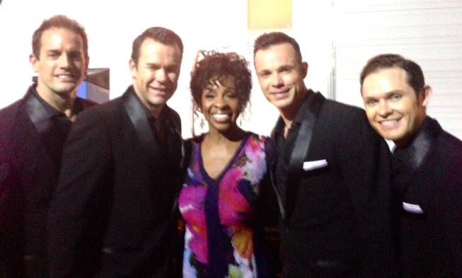 Gladys Knight is flanked by Venetian headliners Human Nature at the Apollo Theater's 80th anniversary celebration at Apollo Theater in New York on Tuesday, June 10, 2014.