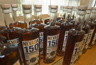 "Bottles of ""Nevada 150"" bourbon whiskey are displayed during ""Bourbon Day"" at the Las Vegas Distillery in Henderson Saturday, June 14, 2014. The bourbon whiskey, the first bourbon produced in Nevada, is named for Nevada's sesquicentennial."