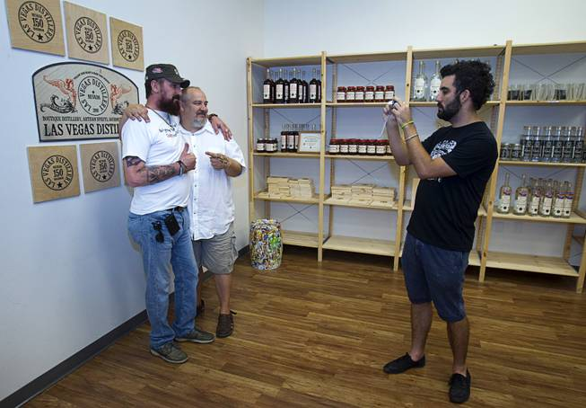 "Steve Brockman takes a photo of Joseph Zecher, left, and Las Vegas Distillery owner George Racz during ""Bourbon Day"" at the distillery in Henderson Saturday, June 14, 2014. The ""Nevada 150"" bourbon whiskey, the first bourbon produced in Nevada, is named for Nevada's sesquicentennial."