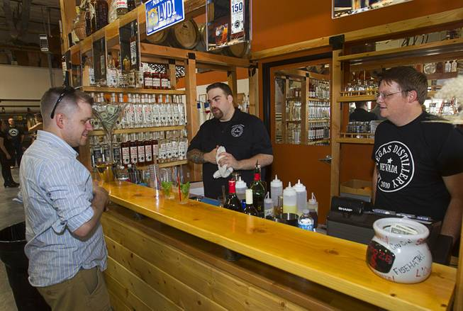 "Bartenders Cody Fredrickson, left, and Travis Nichol mix bourbon cocktails during ""Bourbon Day"" at the Las Vegas Distillery in Henderson Saturday, June 14, 2014. The ""Nevada 150"" bourbon whiskey, the first bourbon produced in Nevada, is named for Nevada's sesquicentennial."