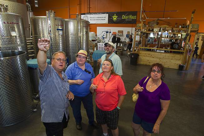 "Guests take a tour of the Las Vegas Distillery during ""Bourbon Day"" at the distillery in Henderson Saturday, June 14, 2014. The ""Nevada 150"" bourbon whiskey, the first bourbon produced in Nevada, is named for Nevada's sesquicentennial."
