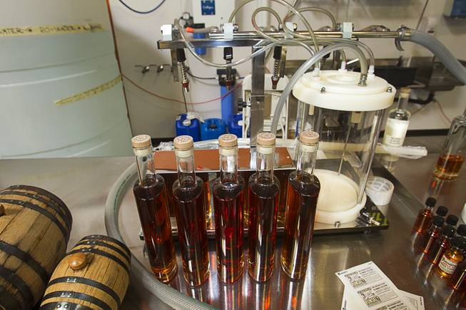 "Bottles of ""Nevada 150"" bourbon whiskey wait for labels during ""Bourbon Day"" at the Las Vegas Distillery in Henderson Saturday, June 14, 2014. The bourbon whiskey, the first bourbon produced in Nevada, is named for Nevada's sesquicentennial."