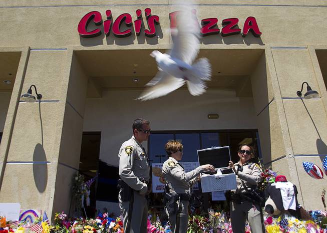 "Metro Police officers Ion Iliescu, Lourdes Smith and  Michelle Wilson release two white doves during ""Sharing Our Support,"" a fundraiser for the families of Metro Police Officers Igor Soldo and Alyn Beck, at CiCi's Pizza Sunday, June 15, 2014. The doves were provided by Gabriel Arambula of G&G White Dove Release of Las Vegas."