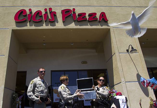 "Metro Police officers Ion Iliescu, Lourdes Smith and  Michelle Wilson release the second of two white doves during ""Sharing Our Support,"" a fundraiser for the families of Metro Police Officers Igor Soldo and Alyn Beck, at CiCi's Pizza Sunday, June 15, 2014. The officers were ambushed and killed at the restaurant while eating lunch on Sunday, June 8. One hundred percent of the Sunday sales will go the families of the fallen officers and Joseph Willcox, the victim killed at the Wal-Mart, said store owner Mike Haskins."