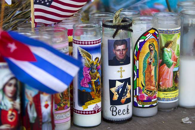"A prayer candle dedicated to Metro Police Officer Alyn Beck is shown during ""Sharing Our Support,"" a fundraiser for the families of Metro Police Officers Igor Soldo and Beck, at CiCi's Pizza Sunday, June 15, 2014. The officers were ambushed and killed at the restaurant while eating lunch on Sunday, June 8. One hundred percent of the Sunday sales will go the families of the fallen officers and Joseph Willcox, the victim killed at the Wal-Mart, said store owner Mike Haskins."