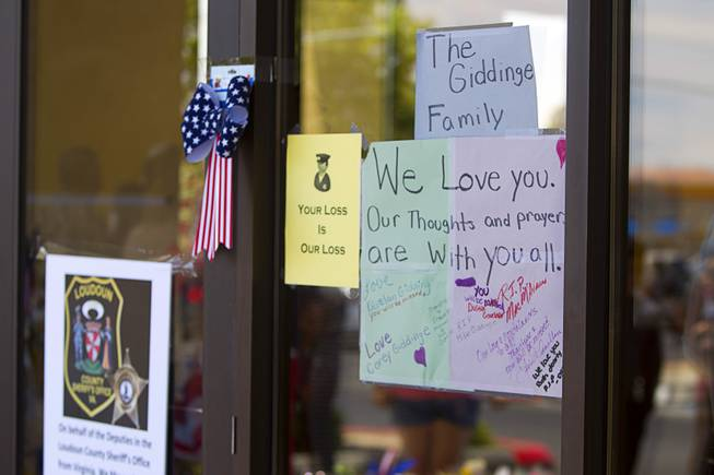 "A sign of support is shown during ""Sharing Our Support,"" a fundraiser for the families of Metro Police Officers Igor Soldo and Alyn Beck, at CiCi's Pizza Sunday, June 15, 2014. The officers were ambushed and killed at the restaurant while eating lunch on Sunday, June 8. One hundred percent of the Sunday sales will go the families of the fallen officers and Joseph Willcox, the victim killed at the Wal-Mart, said store owner Mike Haskins."