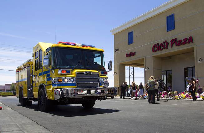 "Clark County Firefighters arrive for ""Sharing Our Support,"" a fundraiser for the families of Metro Police Officers Igor Soldo and Alyn Beck, at CiCi's Pizza Sunday, June 15, 2014. The officers were ambushed and killed at the restaurant while eating lunch on Sunday, June 8. One hundred percent of the Sunday sales will go the families of the fallen officers and Joseph Willcox, the victim killed at the Wal-Mart, said store owner Mike Haskins."