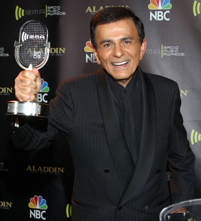 In this Oct. 27, 2003, file photo, Casey Kasem receives the Radio Icon Award during the 2003 Radio Music Awards at the Aladdin in Las Vegas. Kasem, the smooth-voiced radio broadcaster who became the king of the Top 40 countdown, died Sunday, June 15, 2014, according to Danny Deraney, publicist for Kasem's daughter, Kerri. He was 82.