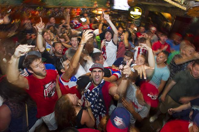 Gershon Levy, center, and other soccer fans celebrate as they watch the United States beat Ghana 2-1 in the World Cup during a viewing party at the Crown & Anchor British Pub Monday, June 16, 2014.