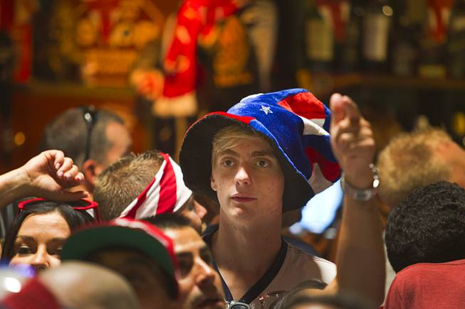 A Soccer fan wears a patriotic hat as he watches the United States play Ghana in the World Cup during a viewing party at the Crown & Anchor British Pub Monday, June 16, 2014.