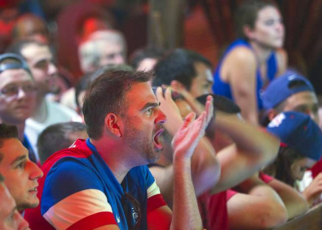 Aaron Pelcher calls out as he watches the United States play Ghana 2-1 in the World Cup during a viewing party at the Crown & Anchor British Pub Monday, June 16, 2014.