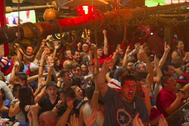 Soccer fans celebrate as they watch the United States beat Ghana 2-1 in the World Cup during a viewing party at the Crown & Anchor British Pub Monday, June 16, 2014.