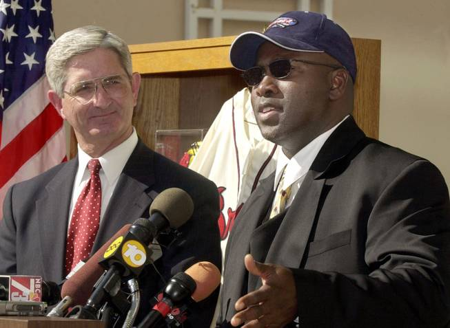 San Diego Padres' Tony Gwynn, right, talks at news conference at  FBI Headquarters in San Diego as Special Agent-In-Charge Willam Gore looks on Wednesday, April 12, 2000. The FBI and the IRS seized over $10 million worth of counterfeit memorabilia after executing warrants in five states.