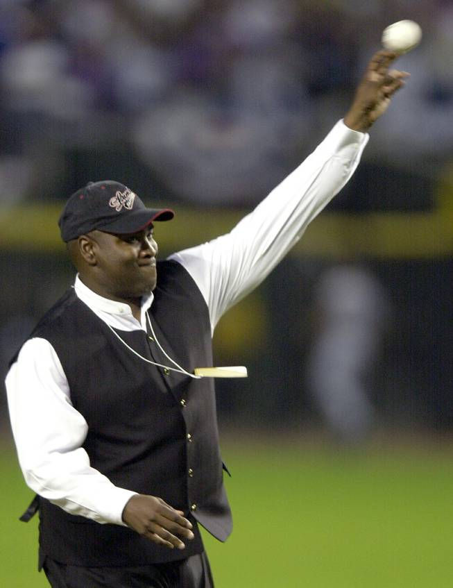 Retired San Diego Padres outfielder Tony Gwynn throws out the first pitch of Game 6 of the World Series between the Arizona Diamondbacks and the New York Yankees Saturday, Nov. 3, 2001, at Bank One Ballpark in Phoenix.
