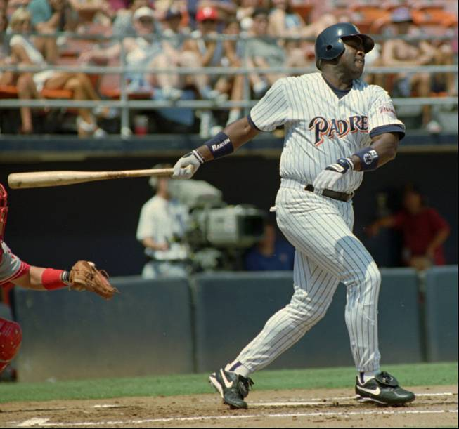 San Diego Padres' right fielder Tony Gwynn connects for a base hit against the Philadelphia Phillies Saturday, Sept. 2, 1995 in San Diego. Gwynn finished the 1995 season with a batting average of .368, winning his sixth National League batting title.
