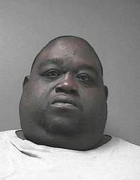 This Friday, June 13, 2014, arrest photo provided by the Volusia County Sheriff's Office, shows Christopher Mitchell, 42. Mitchell, who weighs about 450 pounds, was arrested and is facing multiple charges after sheriff's deputies say he hid cocaine and 23 grams of marijuana under his stomach fat.