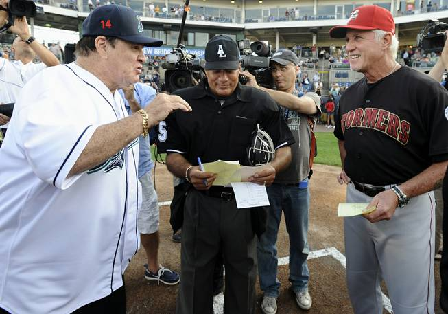 Pete Rose and Lancaster Barnstormers manager Butch Hobson talk at home plate before a game at the Ballpark at Harbor Yard on Monday, June 16, 2014, in Bridgeport, Conn. Rose, banned from Major League Baseball, returned to the dugout for one day to manage the independent minor-league Bridgeport Bluefish.
