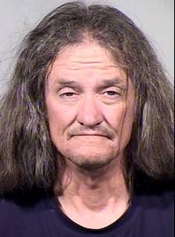 Gary Moran is seen in this June 16, 2014, booking photo provided by the Maricopa County Sheriffs Office. Moran is being held on suspicion of first-degree murder, burglary and armed robbery, among others charges in the killing of a Roman Catholic priest and the beating of a second priest at a downtown Phoenix church.