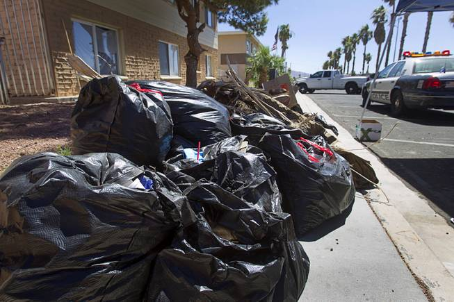 Bags of garbage are shown on Sunrise Avenue during a Downtown Community Coalition neighborhood cleanup near Fremont Street and 21st Street Tuesday, June 17, 2014. An estimated 8 tons of garbage was collected during the event, said Metro Police Officer Aden Ocampo-Gomez. A bobcat from the city's rapid response unit picked up the larger items such as an abandoned couch and discarded mattresses, he said.