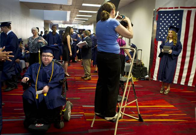 Colton Shrum awaits with friends before his graduation ceremony for the Odyssey Charter School at the Cashman Center on Tuesday, June, 3, 2014.