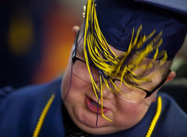 Colton Shrum has his tassel accidentally tangled in his glasses before his graduation ceremony for the Odyssey Charter School at the Cashman Center on Tuesday, June, 3, 2014.