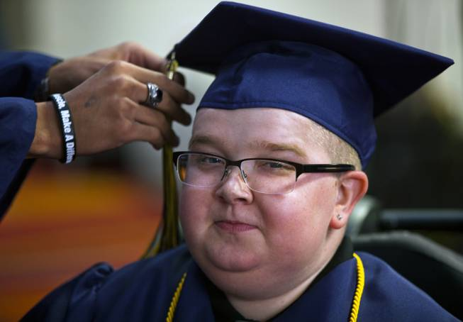 Colton Shrum has his tassel arranged before his graduation ceremony for the Odyssey Charter School at the Cashman Center on Tuesday, June, 3, 2014.