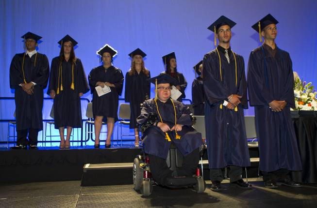 Lifelong friends Colton Shrum, D'Aron Martin and Darius Martin stand with other students at the Cashman Center  for their Odyssey Charter School graduation on Tuesday, June, 3, 2014.