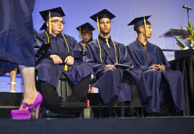 Colton Shrum, D'Aron Martin and Darius Martin sit patiently with other students during the Cashman Center  for their Odyssey Charter School graduation on Tuesday, June, 3, 2014.