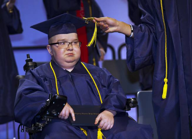 Colton Shrum has his tassel moved across by D'Aron Martin during their Odyssey Charter School graduation at the Cashman Center on Tuesday, June, 3, 2014.
