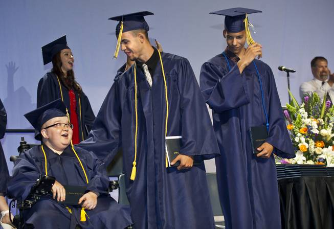 Lifelong friends Darius Martin, Colton Shrum and D'Aron Martin are all smiles during the Odyssey Charter School graduation at the Cashman Center on Tuesday, June, 3, 2014.
