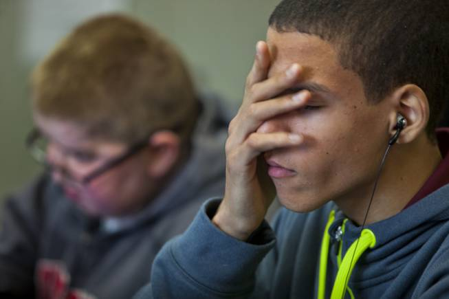 Darius Martin does his best to concentrate on his studies as he and friend Colton Shrum study at Odyssey Charter School on Tuesday, January, 28, 2014.