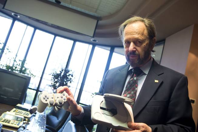 Gilbert Hyatt, local inventor and father of the micro-processor, shows some of the various modern electronic devices that use his patented technologies Thursday April, 3, 2014