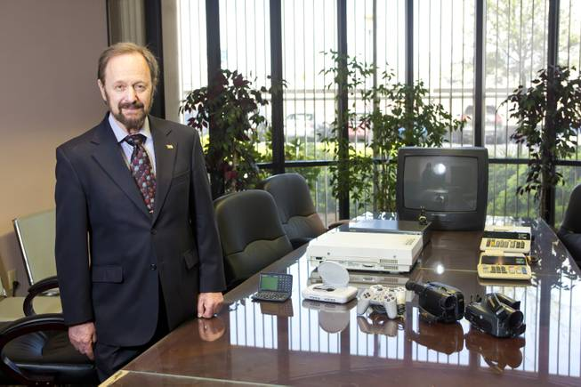 Gilbert Hyatt, local inventor and father of the micro-processor, stands by some of the various modern electronic devices that use his patented technologies Thursday April, 3, 2014