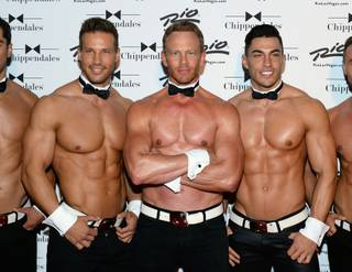 Guest host Ian Ziering is flanked by Sami Eskelin and Jon Howes at Chippendales on Saturday, June 14, 2014, in the Rio.