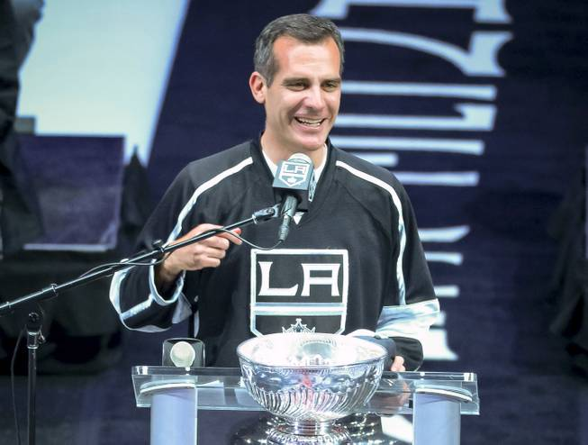 In this photo taken on Monday, June 16, 2014, Los Angeles Mayor Eric Garcetti talks to the crowd during the Los Angeles King's Stanley Cup hockey championship rally at Staples Center in Los Angeles.